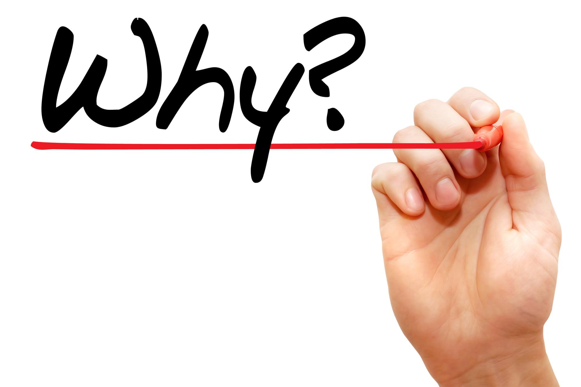 派遣-「Why」という手書きの文字