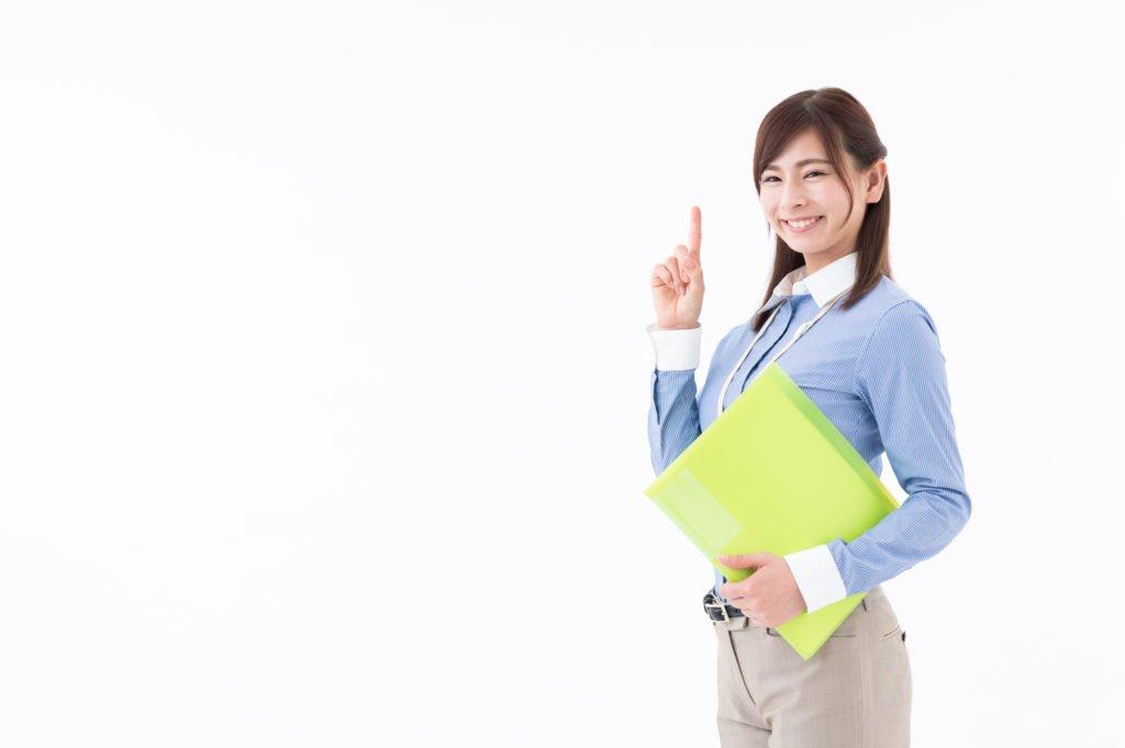 派遣-指をさしている女性