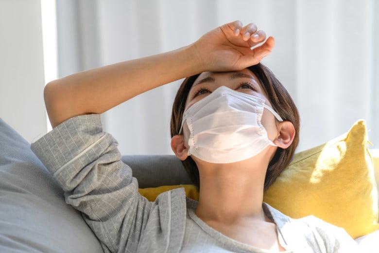 派遣-インフルエンザで寝込む女性派遣社員